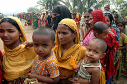 People have to wait for hours to buy 5kg of rice at open market sale (OMS) centers in Bangladesh. Photo: Shamsuddin Ahmed/IRIN