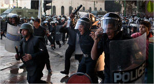 Riot police officers rushed to confront protesters on Tuesday in Cairo. Photo: Scott Nelson/New York Times