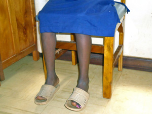 Photo of girl seated in a chair. Girls are still threatened by practices such as child marriage and female genital mutilation.  Photo: Noor Ali/IRIN