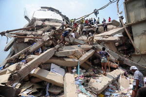 Rescue workers search for surviors of Bangladesh building collapse that killed over 300. Photo: Munir Uz Zaman/Agence France-Presse � Getty Images