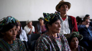 Relatives of victims of Guatemala's civil war listened to proceedings as Efra�n R�os Montt, Guatemala�s former military dictator, was ordered by a Guatemalan judge on Thursday to stand trial on charges of genocide and crimes against humanity leveled at him. Rodrigo Abd/Associated Press
