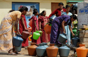 Indian residents in a district facing a drinking water shortage wait with plastic pots at a community tube well to collect drinking water in Bangalore on October 8, 2012. Photo: Manjunath Kiran/AFP/Getty Images