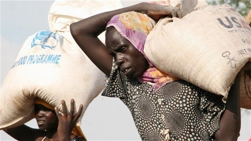 Women at Doro refugee camp in South Sudan collect their monthly food rations. Photo: Stephen Graham/IRIN