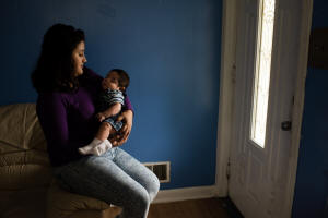 Wendy Hernandez, 16, holds her 4-month-old son, Anthony, in their Hyattsville, Md., home, which is owned by her boyfriend's mother. (Sarah L. Voisin/The Washington Post)